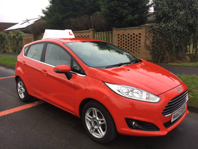 Red Ford Fiesta used by Progress Driving School Lowton
