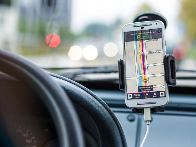 mobile phone in holder of car window